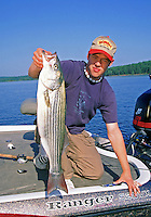 Young man shows nice striper from Lake Ouachita, Arkansas