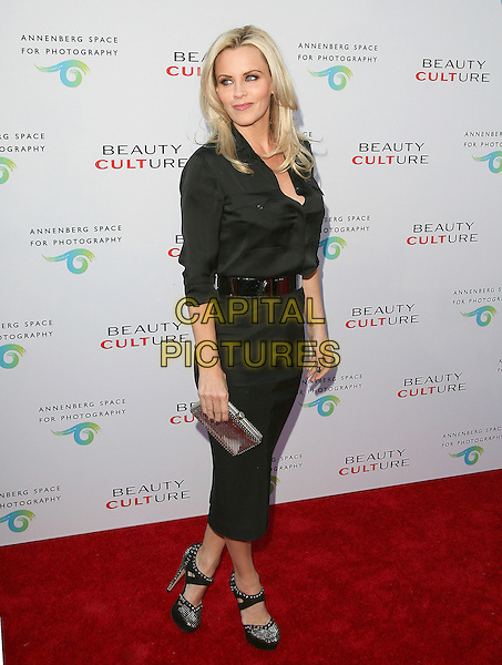 JENNY McCARTHY .at The opening of Beauty Culture - a photographic exploration of how feminine beauty is defined, challenged and revered in modern society held at Annenberg Space for Photography in Century City, California, USA,  .May 19th 11..full length skirt pencil  clutch bag shoes  black shirt belt                                            .CAP/RKE/DVS.©DVS/RockinExposures/Capital Pictures.