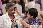 Zenaida Remigio anoints the head of Yvette Moore with oil on January 17, 2018, during an international gathering of United Methodist Women in Manila. <br /> <br /> Remigio, a deaconess, is an officer of the United Methodist Women's Society for Christian Service. Moore is communications director for United Methodist Women.
