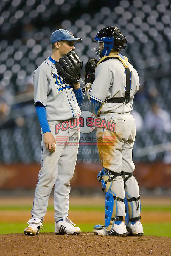 Trevor Bauer #11 of the UCLA Bruins chats with catcher Steve Rodriguez #3 during their game versus the Rice Owls in the 2009 Houston College Classic at Minute Maid Park February 27, 2009 in Houston, TX.  The Owls defeated the Bruins 5-4 in 10 innings. (Photo by Brian Westerholt / Four Seam Images)