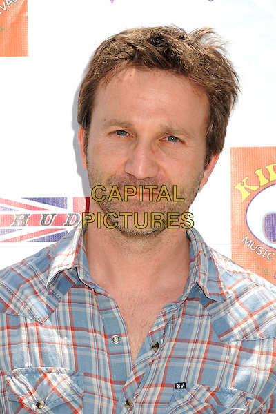 Breckin Meyer.6th Annual Kidstock Music and Art Festival held at Greystone Mansion, West Hollywood, California USA..3rd June 2012.headshot portrait red white stubble facial hair blue check shirt .CAP/ADM/BP.©Byron Purvis/AdMedia/Capital Pictures.