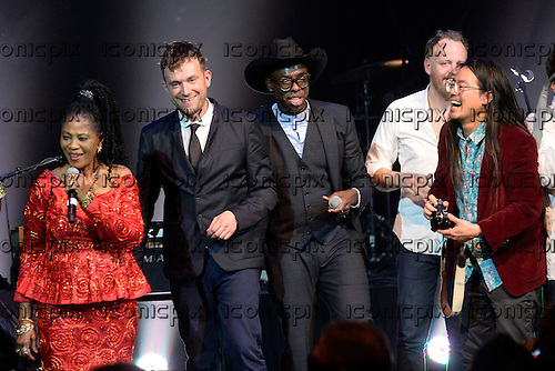 L-R: one of the Lijadu Sisters, Damon Albarn, Ghostpoet, Pat Mahoney (LCD Soundsystem), Jonny Lam (Sinkane) - performing live as Atomic Bomb : Who is William Onyeabor at the Barbican Hall in London UK - 01 April 2014.  Photo credit: George Chin/IconicPix