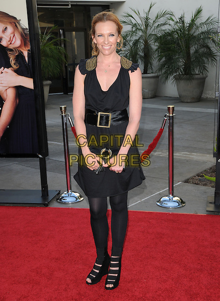 "TONI COLLETTE .The Universal Pictures' Premiere of ""Funny People"" held at The Arclight Theatre in Hollywood, California, USA..July 20th, 2009.full length black dress gold belt buckle tights shoes clutch bag .CAP/DVS.©Debbie VanStory/Capital Pictures."