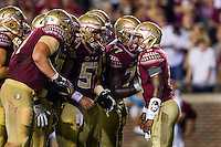 TALLAHASSEE, FLA. 9/5/15-Florida State University quarterback Everett Golson, right, calls a play in the huddle during first half action against Texas State University at Doak Campbell Stadium in Tallahassee.<br /> <br /> COLIN HACKLEY PHOTO