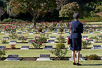 A woman lokks at war graves after the Remembrance Sunday ceremony at the Hodogaya, Commonwealth War Graves Cemetery in Hodogaya, Yokohama, Kanagawa, Japan. Sunday November 12th 2017. The Hodagaya Cemetery holds the remains of more than 1500 servicemen and women, from the Commonwealth but also from Holland and the United States, who died as prisoners of war or during the Allied occupation of Japan. Each year officials from the British and Commonwealth embassies, the British Legion and the British Chamber of Commerce honour the dead at a ceremony in this beautiful cemetery.