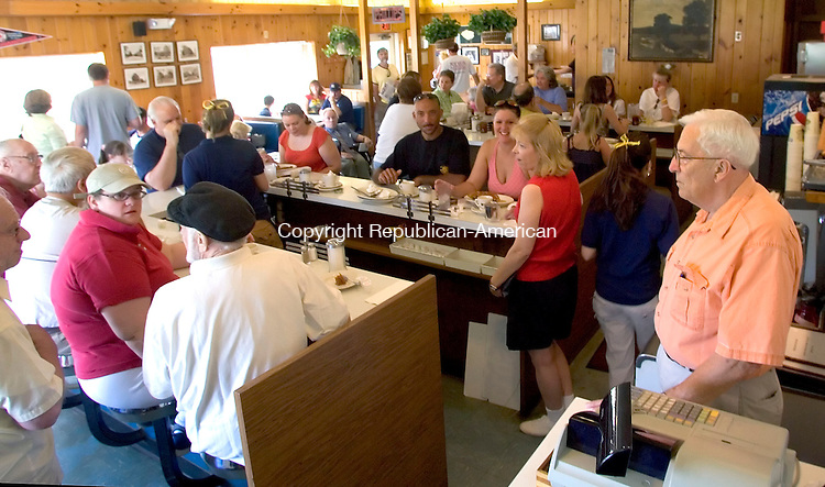 WOODBURY, CT--04 JULY 2006 -070406JS10-Bud Phillips, right, owner of Phillips Diner in Woodbury,  looks over his diner full of loyal customers during his last day of ownership of the diner on Tuesday. -- Jim Shannon Republican-American