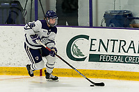 WORCESTER, MA - FEBRUARY 08: Emma Lange #16 of Holy Cross brings the puck forward during a game between Boston University and College of the Holy Cross at Hart Center Rink on February 08, 2020 in Worcester, Massachusetts.