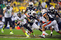 Jan 10, 2011; Glendale, AZ, USA; Oregon Ducks wide receiver Lavasier Tuinei (80) runs after a catch during the second half of the 2011 BCS National Championship game against the Auburn Tigers at University of Phoenix Stadium.  Mandatory Credit: Mark J. Rebilas-
