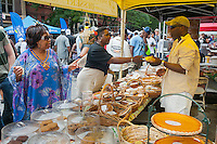 Sweet Potato and pecan pies and other baked goods at a stand during the Harlem Week street fairon West 135th Street in Harlem in New York on Sunday, August 19, 2012. (© Richard B. Levine)