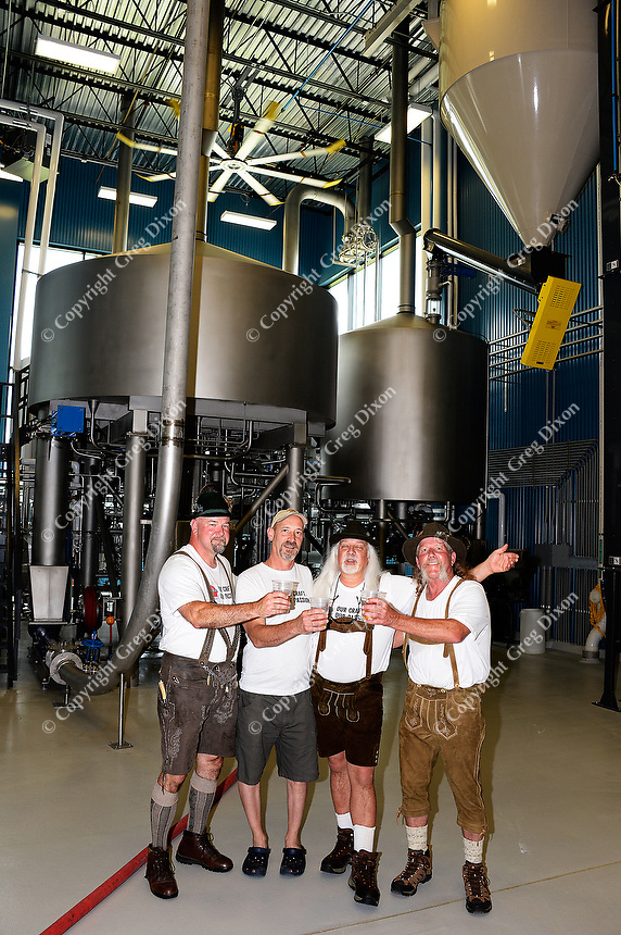 Brewmasters Pat Keller (Great Dane, Fitchburg), Tom Porter (Lake Louie), Kirby Nelson and Mike McGuire (Wisconsin Brewing; L-R) toast the creation of Wisconsin Brewing Company's Depth Charge Scotch Ale on Sunday, July 12, 2015, in Verona, Wisconsin.