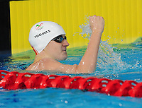 Wales' Jack Thomas celebrates taking the bronze medal in the men's para-sport 200m freestyle S14 final<br /> <br /> Photographer Chris Vaughan/CameraSport<br /> <br /> 20th Commonwealth Games - Day 3 - Saturday 26th July 2014 - Swimming - Tollcross International Swimming Centre - Glasgow - UK<br /> <br /> © CameraSport - 43 Linden Ave. Countesthorpe. Leicester. England. LE8 5PG - Tel: +44 (0) 116 277 4147 - admin@camerasport.com - www.camerasport.com