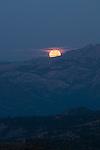 Full moon setting over the Sierra Nevada, Toiyabe National Forest, California