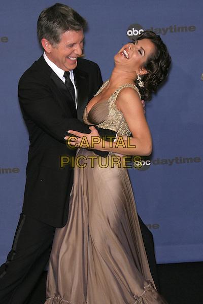 TOM BERGERON & KELLY MONACO.The 33rd Annual Daytime Emmy Awards - Press Room held at the Kodak Theatre, Hollywood, California, USA, .28 April 2005..emmys half length funny.Ref: ADM/ZL.www.capitalpictures.com.sales@capitalpictures.com.©Zach Lipp/AdMedia/Capital Pictures.