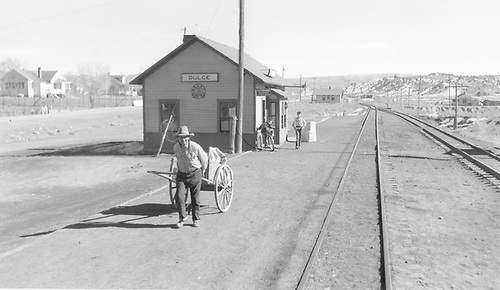 A Jicarilla Apache mailman heads for the Dulce post office with the mail dropped off by the San Juan.<br /> D&amp;RGW  Dulce, NM  Taken by Richardson, Robert W. - 1/22/1951
