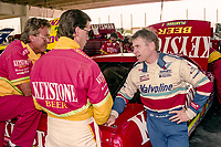 Wally Dallenbach Jr, center, and Mark Martin, R, talk in the garage, Winston 500, Talladega Superspeedway, Talladega, Alabama, May 1992.(Photo by Brian Cleary/bcpix.com)