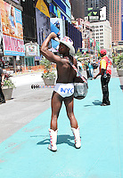 NEW YORK, NY - JUNE 21: The Black Naked Cowboy in the green zone on the first day of NYPD (New York Police Department) enforcement of the new pedestrian zones in Times Square where costumed characters and those selling bus or show tickets are required to solicit only in the designated green zone in New York, New York on June 21, 2016.  Photo Credit: Rainmaker Photo/MediaPunch