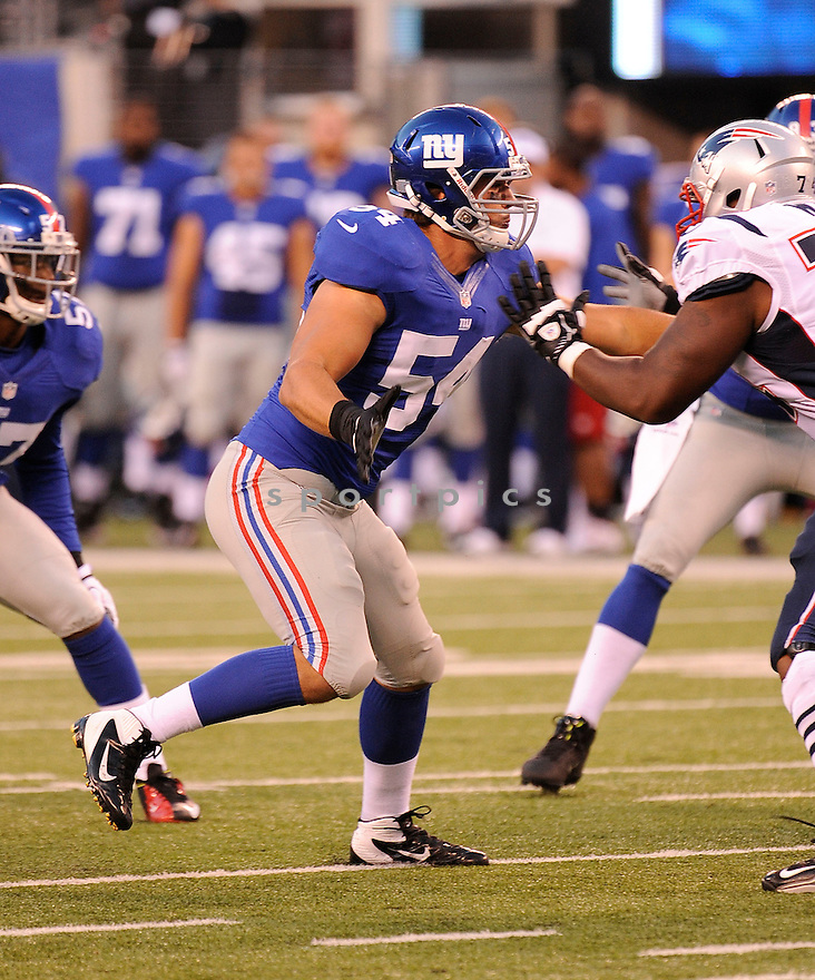 MATT BROHA (54) of the New York Giants, in action during the Giants preseason game against the New England Patriots on August 29, 2012 at MetLife Stadium in East Rutherford, NJ. The Giants beat the Patriots 6-3.
