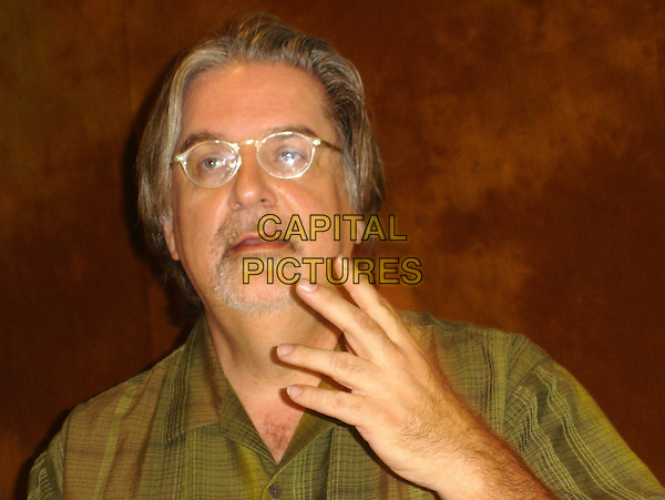 "MATT GROENING.Photocall for ""The Simpsons Movie"" at The Four Seasons, California, USA..July 22nd, 2007.headshot portrait hand glasses goatee facial hair .CAP/AW.©Anita Weber/Capital Pictures"