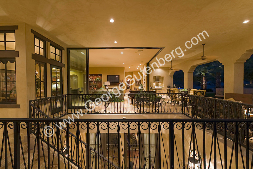 View overlooking staircase in large patio area of luxury home