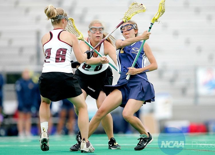 22 MAY 2005: The College of New Jersey's Karen Doane (right) attempts to evade Salisbury University's Jessica Froats (26) and Regan Miller (29) during the Division III Women's Lacrosse Championship in Ewing, NJ. The College of New Jersey defeated Salisbury University 9-7 to take home their 12th title.  J. Andrew Hallowell/NCAA Photos