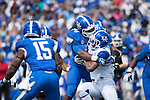 Defensive end Za'Darius Smith (94) plows into running back Mikel Horton (4) during the Blue/White Spring Game in Lexington, Ky., on Saturday, April 26, 2014. Blue defeated White 38-14. Photo by Adam Pennavaria | Staff