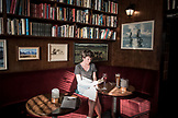 NEW ZEALAND, Wellington, Woman Reading in Library Bar, Ben M Thomas