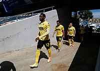 18th July 2020; The Kiyan Prince Foundation Stadium, London, England; English Championship Football, Queen Park Rangers versus Millwall; Mahlon Romeo, Mason Bennett  and Ryan Woods of Millwall walking from the away tunnel onto the pitch before kick off