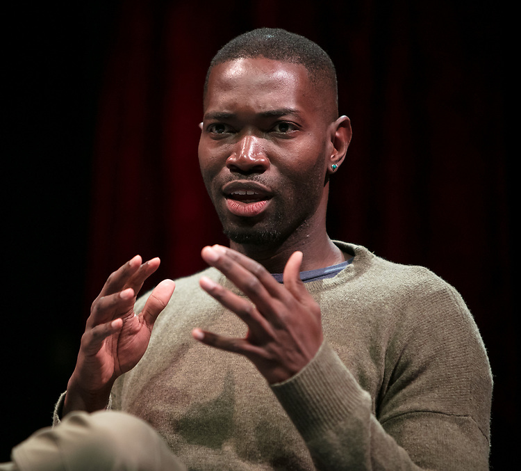 """Tarell Alvin McCraney, playwright of """"Wig Out!"""" and Oscar award winning playwright and screenwriter for """"Moonlight,"""" talks with students, faculty and staff from the set of """"Wig Out!"""" on the Fullerton Stage in The Theatre School building, Friday, April 21, 2017. (DePaul University/Jeff Carrion)"""
