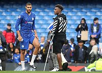 Chelsea's Ruben Loftus-Cheek and the injured, Callum Hudson-Odoi on the pitch after the match during Chelsea vs Watford, Premier League Football at Stamford Bridge on 5th May 2019
