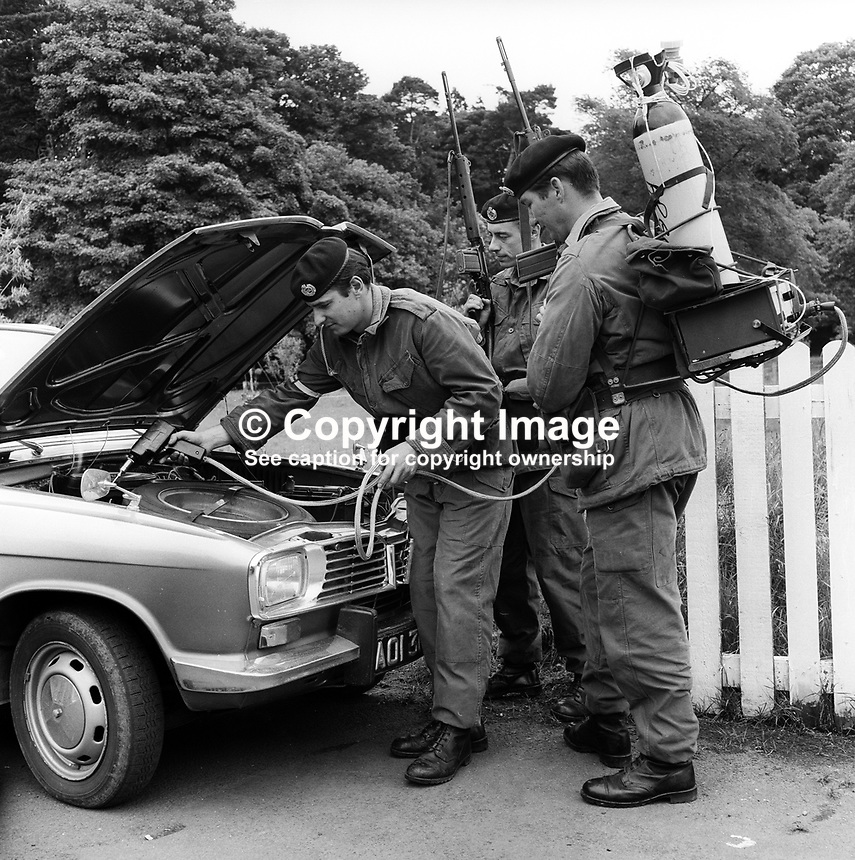 British soldiers serving in N Ireland demonstrate a device for detecting gelignite. Has the appearance of a prototype. 1st July 1971. 197107010254<br />