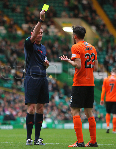 25.10.2015. Glasgow, Scotland. Scottish Premier League. Celtic versus Dundee United. Scott Fraser is booked for his challenge in the box