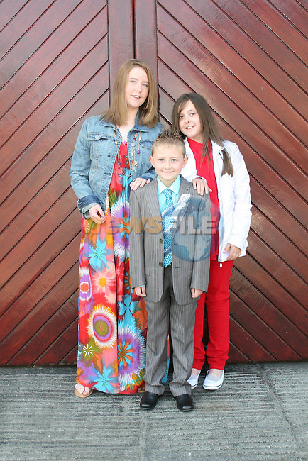 Sean, Jade and Lauren Collier at the St. Marys Congress Avenue Communion in St. Marys Church...Photo NEWSFILE/Jenny Matthews.(Photo credit should read Jenny Matthews/NEWSFILE)....This Picture has been sent you under the condtions enclosed by:.Newsfile Ltd..The Studio,.Millmount Abbey,.Drogheda,.Co Meath..Ireland..Tel: +353(0)41-9871240.Fax: +353(0)41-9871260.GSM: +353(0)86-2500958.email: pictures@newsfile.ie.www.newsfile.ie.FTP: 193.120.102.198.