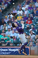 LSU Tigers catcher Alex Milazzo (20) catches a pop fly behind home plate during the game against the Baylor Bears in game five of the 2020 Shriners Hospitals for Children College Classic at Minute Maid Park on February 29, 2020 in Houston, Texas. The Bears defeated the Tigers 6-4. (Brian Westerholt/Four Seam Images)