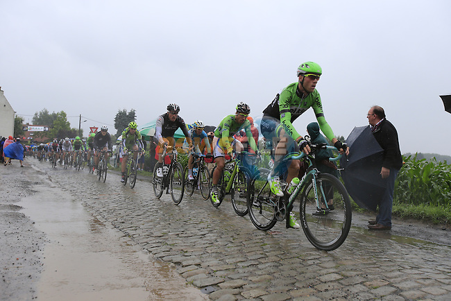 Riders including Lars Boom (NED) Belkin and Peter Sagan (SVK) Cannondale tackle the1st cobbled sector 9 from Gruson to Crossroads de l'Arbe during Stage 5 of the 2014 Tour de France running 155.5km from Ypres to Arenberg. 9th July 2014.<br /> Picture: Eoin Clarke www.newsfile.ie