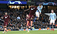 Manchester City's John Stones directs a headed effort towards goal under pressure from 1899 Hoffenheim's Kasim Adamsonly <br /> <br /> Photographer Rich Linley/CameraSport<br /> <br /> UEFA Champions League Group F - Manchester City v TSG 1899 Hoffenheim - Wednesday 12th December 2018 - The Etihad - Manchester<br />  <br /> World Copyright © 2018 CameraSport. All rights reserved. 43 Linden Ave. Countesthorpe. Leicester. England. LE8 5PG - Tel: +44 (0) 116 277 4147 - admin@camerasport.com - www.camerasport.com