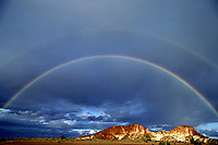 A dramatic storm with two rainbows over Rainbow valley 60 miles south of Alice Springs, Central Australia.<br /> This place is called rainbow valley due to its colors in the rockformation