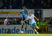 Nick Freeman of Wycombe Wanderers battles Alex Pike of West Ham United U21s during the The Checkatrade Trophy match between Wycombe Wanderers and West Ham United U21 at Adams Park, High Wycombe, England on 4 October 2016. Photo by Andy Rowland.