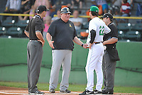 Manager Mark Haley #51 of the South Bend Silver Hawks meets at home plate prior the game against the Clinton LumberKings at Ashford University Field on July 26, 2014 in Clinton, Iowa. The Sliver Hawks won 2-0.   (Dennis Hubbard/Four Seam Images)