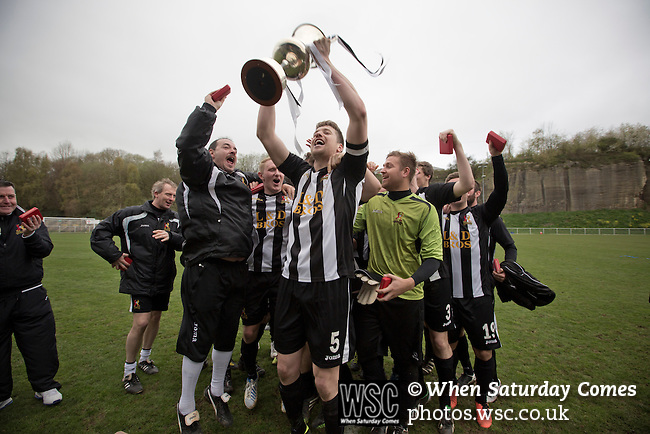 Cefn Druids AFC 1 Buckley Town 0, 12/04/2014. The Rock, Cymru Alliance league. Home team captain Gareth Edwards lifting the league trophy at The Rock, Rhosymedre, home to Cefn Druids AFC, after the club's final home game of the season against Buckley Town (in yellow) in the Cymru Alliance league. Druids, reputedly the oldest football club in Wales, won the Alliance league the previous week and were awarded the trophy after the Buckley Town match, which they won by 1 goal to nil, watched by a crowd of 246. The Cymru Alliance was the second tier of Welsh football based in north and mid Wales, promotion from which led directly into the Welsh Premier League. Photo by Colin McPherson.