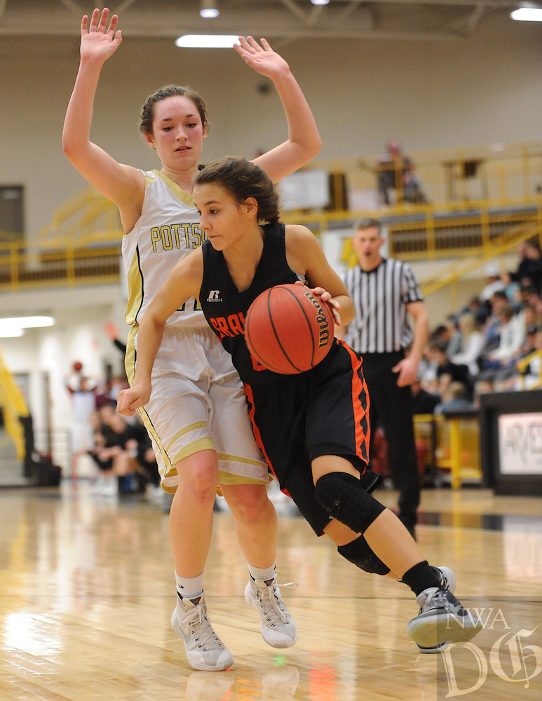 NWA Democrat-Gazette/ANDY SHUPE<br /> Tori Foster (right) of Gravette drives around Madi Rust of Pottsville Wednesday, Feb. 24, 2016, during the second half of play in the 4A North Regional Tournament in Tiger Arena in Prairie Grove. Visit nwadg.com/photos to see more photographs from the game.