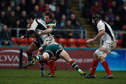 05.03.2011 Brad Barritt is tackled by James Grindal (top) and Anthony Allen (botton) as Steve Borthwick looks on.  Rugby Union Aviva Premiership from Welford Road.  Final score: leicester Tigers 14-15 Saracens.