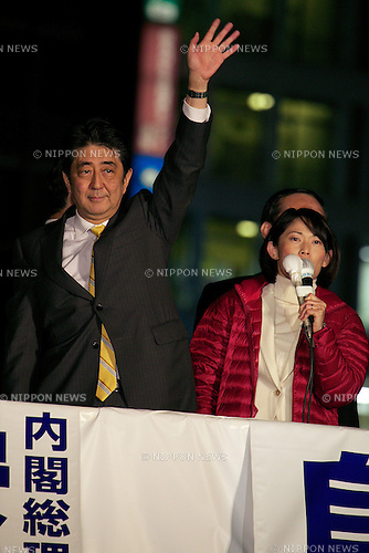 "Shinzo Abe, November 28, 2014 : Japan's Prime Minister and leader of the Liberal Democratic Party (LDP) Shinzo Abe speaks to pedestrians and media outside Shinjuku Station on November 28, 2014 in Tokyo, Japan. Abe dissolved the Lower House of Japan's Parliament calling a surprise general election for December 14 just 2 years in to his 4 year term. The election is seen as a way to bolster support for Abe's policies including ""Abenomics"" and his decision to delay a planned rise in Japan's consumption tax rate to 10 percent until April 2017. (Photo by Rodrigo Reyes Marin/AFLO("