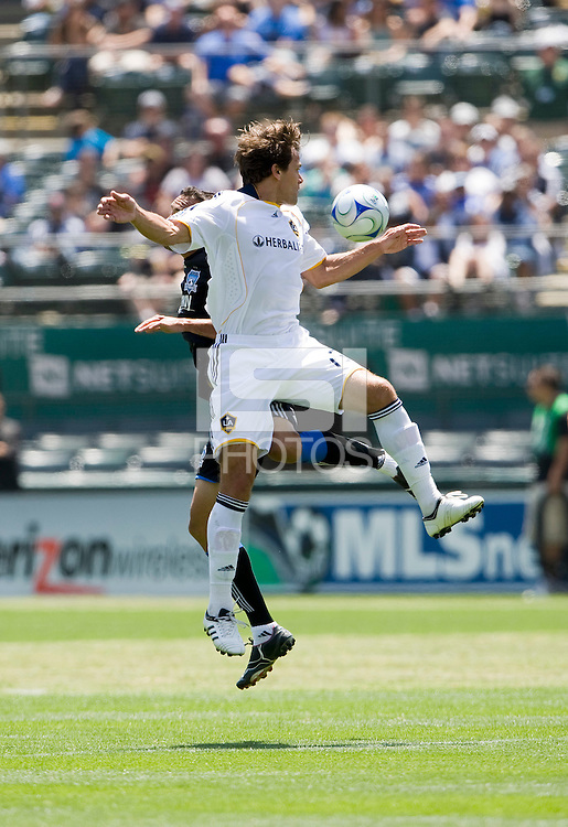 June 20, 2009:  Stefani Miglioranzi of Galaxy jumps for the ball during a game at Coliseum in Oakland, California. San Jose Earthquakes defeated Los Angeles, 2-1