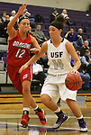 SIOUX FALLS, SD - JANUARY 16:  Jaicee Ulmer #14 from the University of Sioux Falls drives against Meghan Roehrich #12 from Minnesota Moorhead in the second half of their game Friday night at the Stewart Center.  (Photo by Dave Eggen/Inertia)
