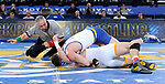 BROOKINGS, SD - JANUARY 18: Martin Mueller from South Dakota State University rolls Chaz Polson from Wyoming to his back for the fall during their 184 pound match Thursday night at Frost Arena in Brookings. (Photo by Dave Eggen/Inertia)