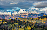 Uncompahgre National Forest CO: Afternoon clouds over Owl Creek Pass and Cimarron Range in fall.