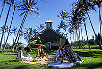 A Hawaiian wedding picnic on the grounds of charming Keanae Church on the road to Hana.