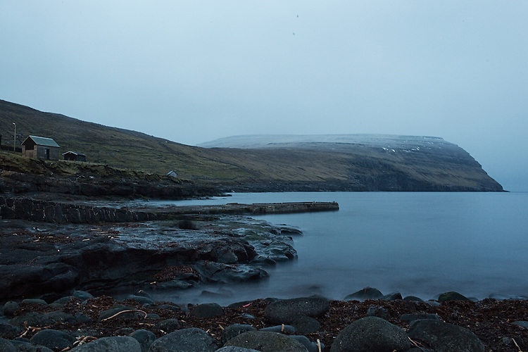The pier sits still as the village of Svínoy settles down for the night in the Faroe Islands.