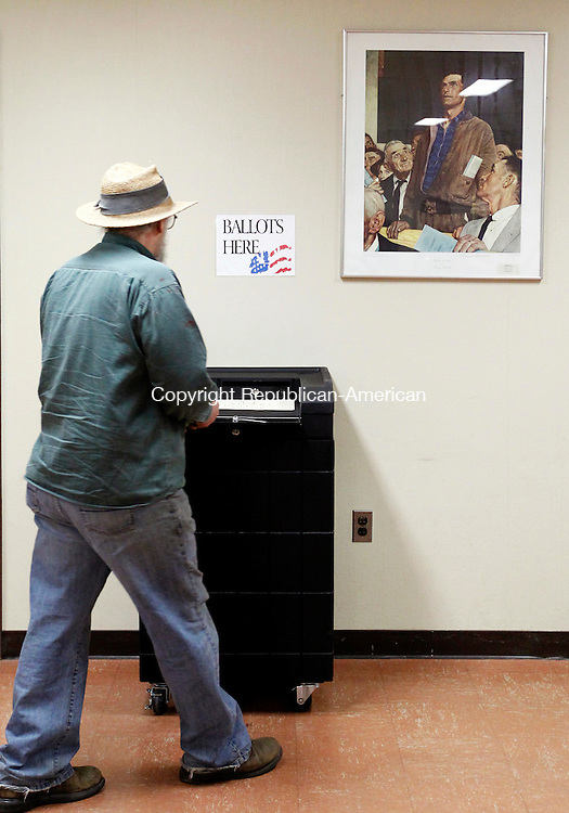 Plymouth, CT-24 March 2012-032412CM05- Town resident, John Osowiecki casts his ballot in the town referendum Saturday morning in Plymouth. The referendum will decide whether to raise taxes for curbside trash pickup.     Christopher Massa Republican-American