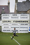 A Fraserburgh player is framed by an advertisement showing the names of local fishing boats at Bellslea Park, during the club's Highland League fixture against visitors Strathspey Thistle. Nicknamed 'The Broch,' Fraserburgh have been members of the Highland League since 1921 having been formed 11 years earlier. The match ended in a 2-2 draw in front of a crowd of 302.